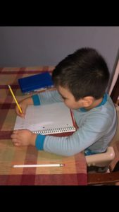 Student practicing writing at home.